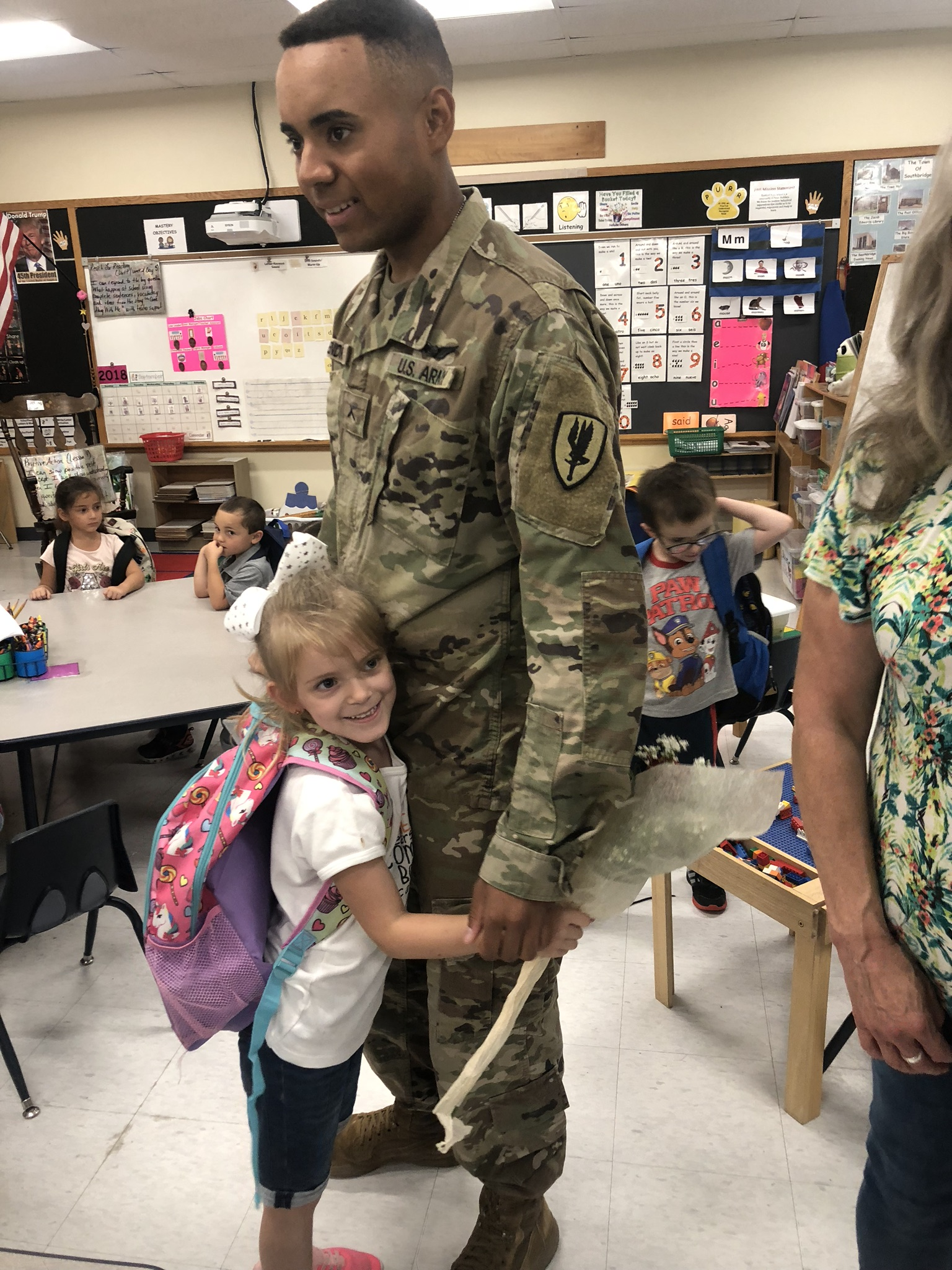 Soldier Surprises His Sister At Eastford Road School