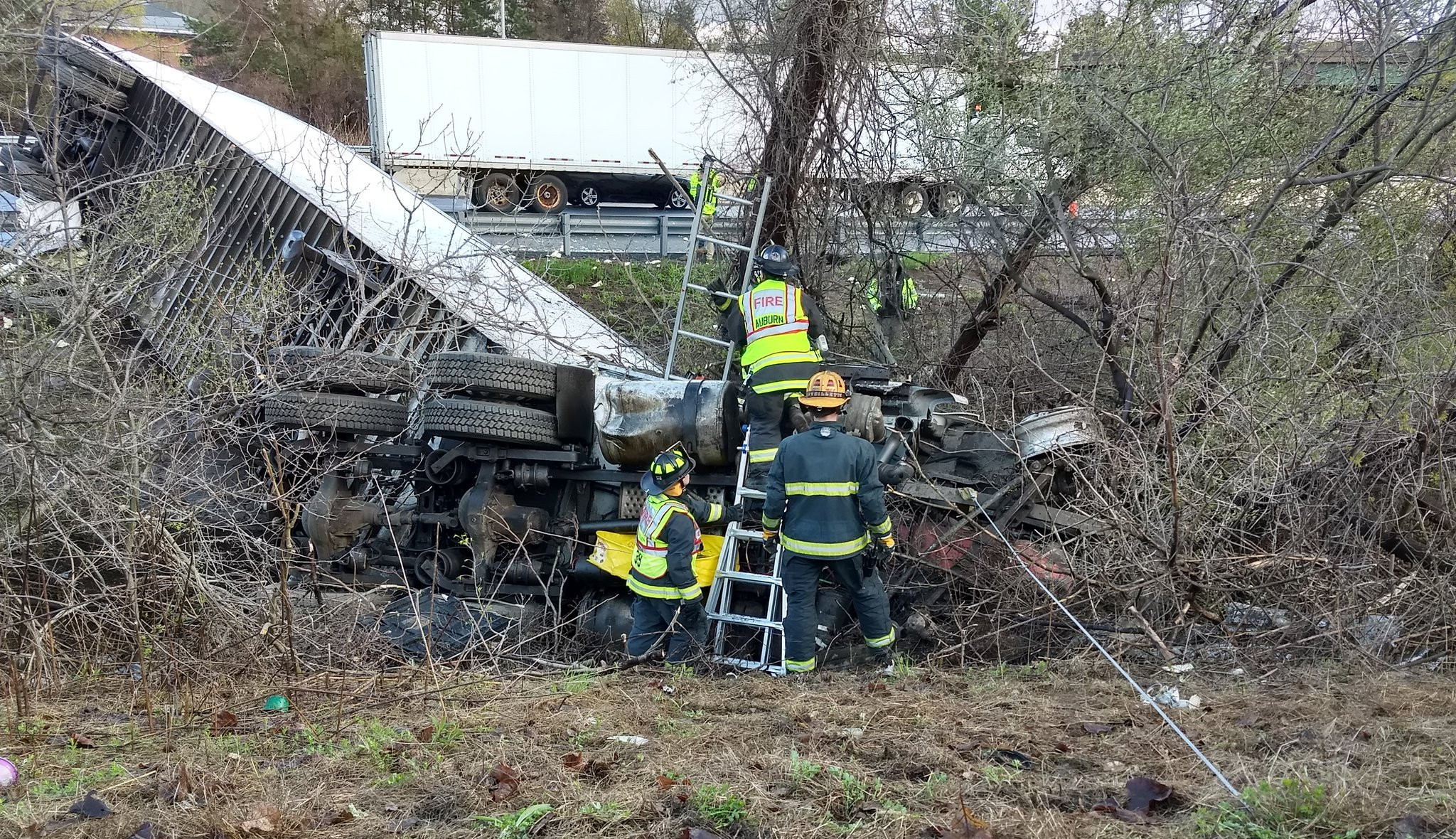 Crews rescue driver trapped in overturned tractor trailer