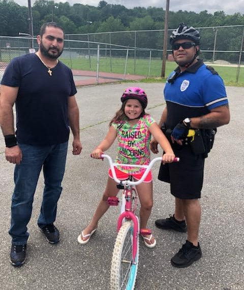 Local business, police team to provide kids with bike helmets