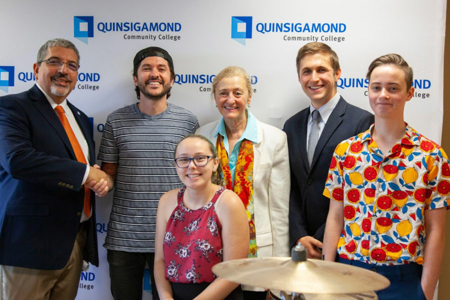 Photo of donor SJC Drums and representatives from Quinsigamond Community College