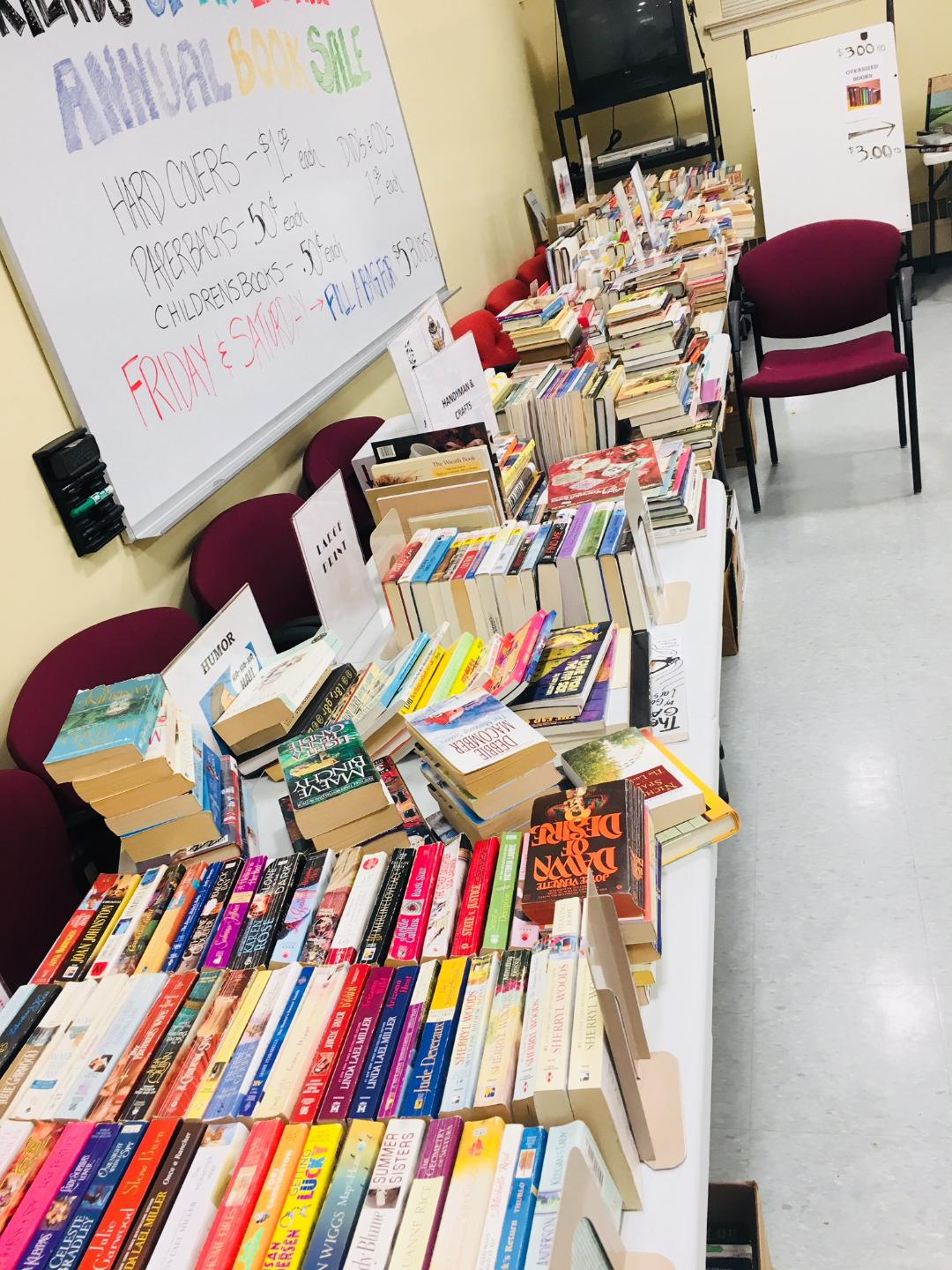 Photo of a previous book sale at Jacob Edwards Library. Books organized on a table.