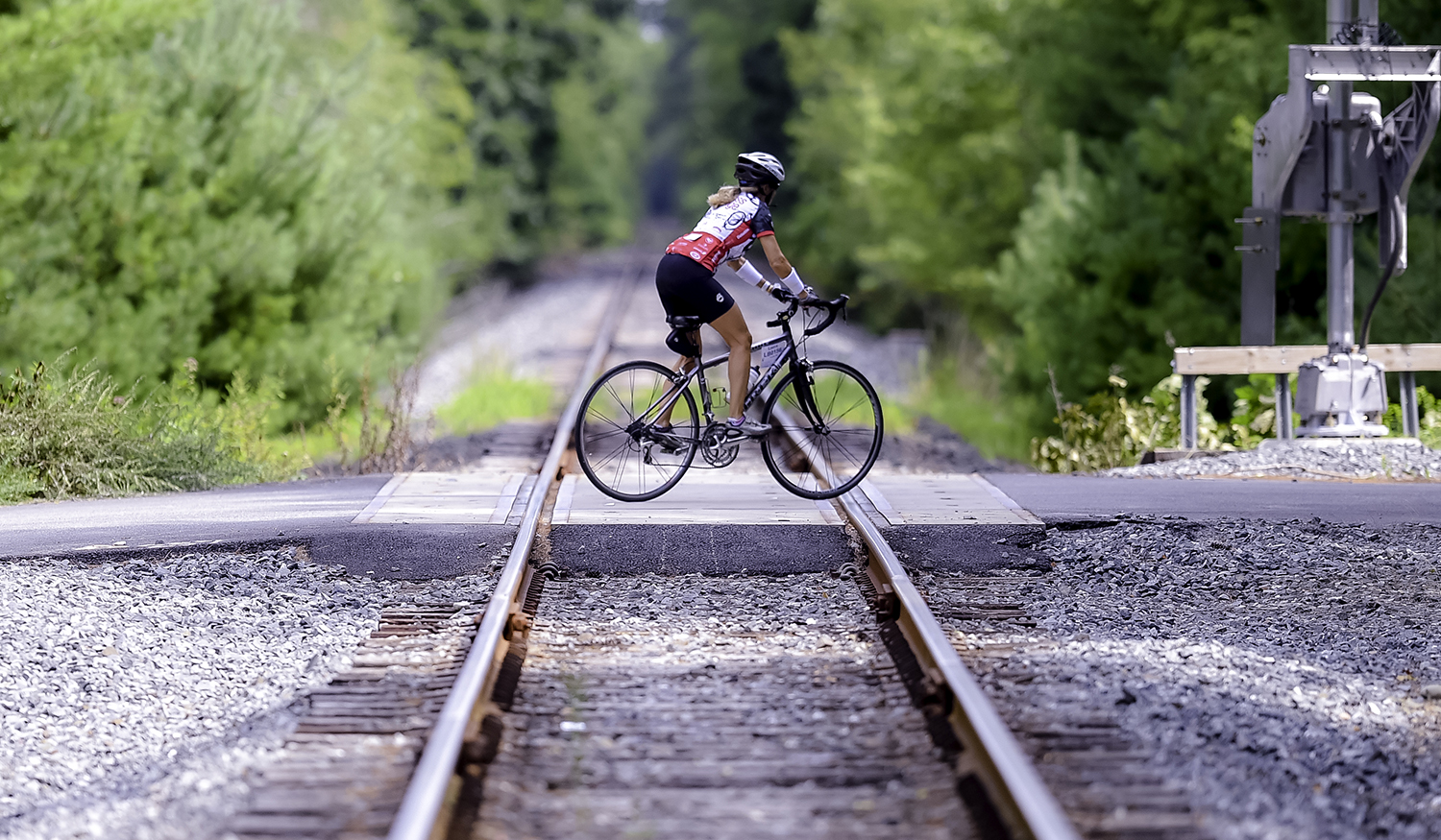 Image of a bicyclist riding over train tracks