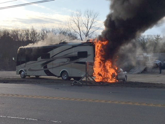 One injured as car accident ignites camper in Charlton