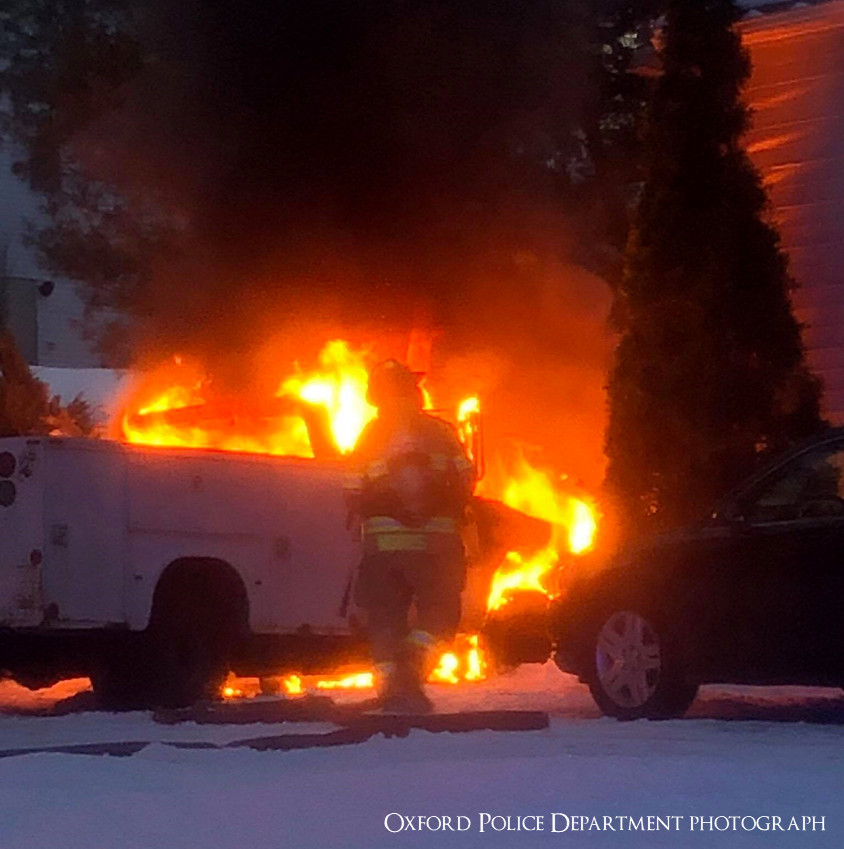 Firefighters stop spread of vehicle fire