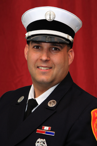 Firefighter accused of assaulting civilian dispatcher