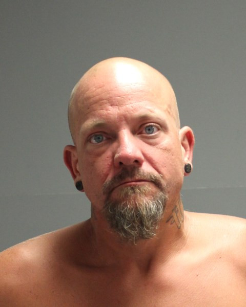 Arrest warrant issued in connection to March robbery